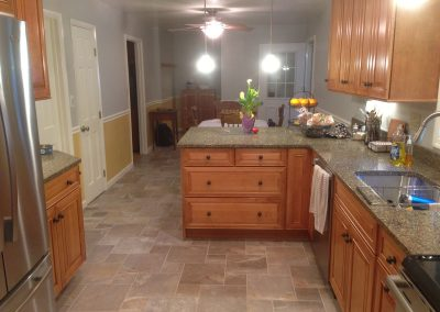 Granite counters and stone tile flooring